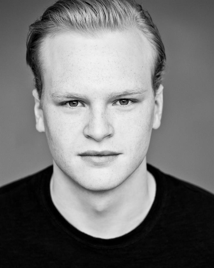 Black and white headshot of Ben Hall