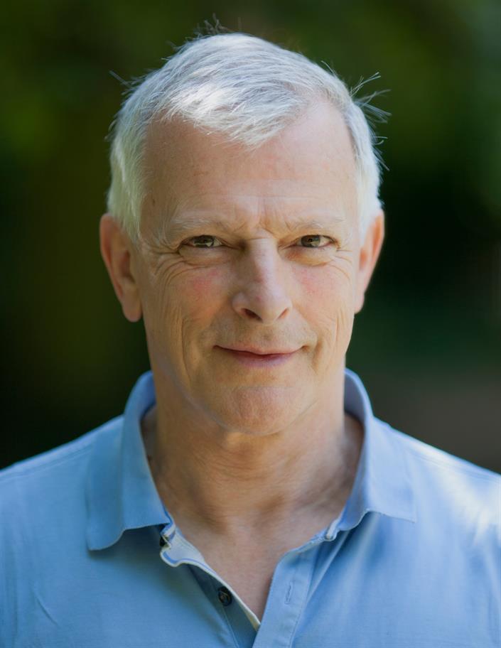 headshot of David Acton in a blue shirt