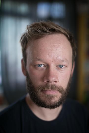 Headshot of Felix Hayes looking at the camera
