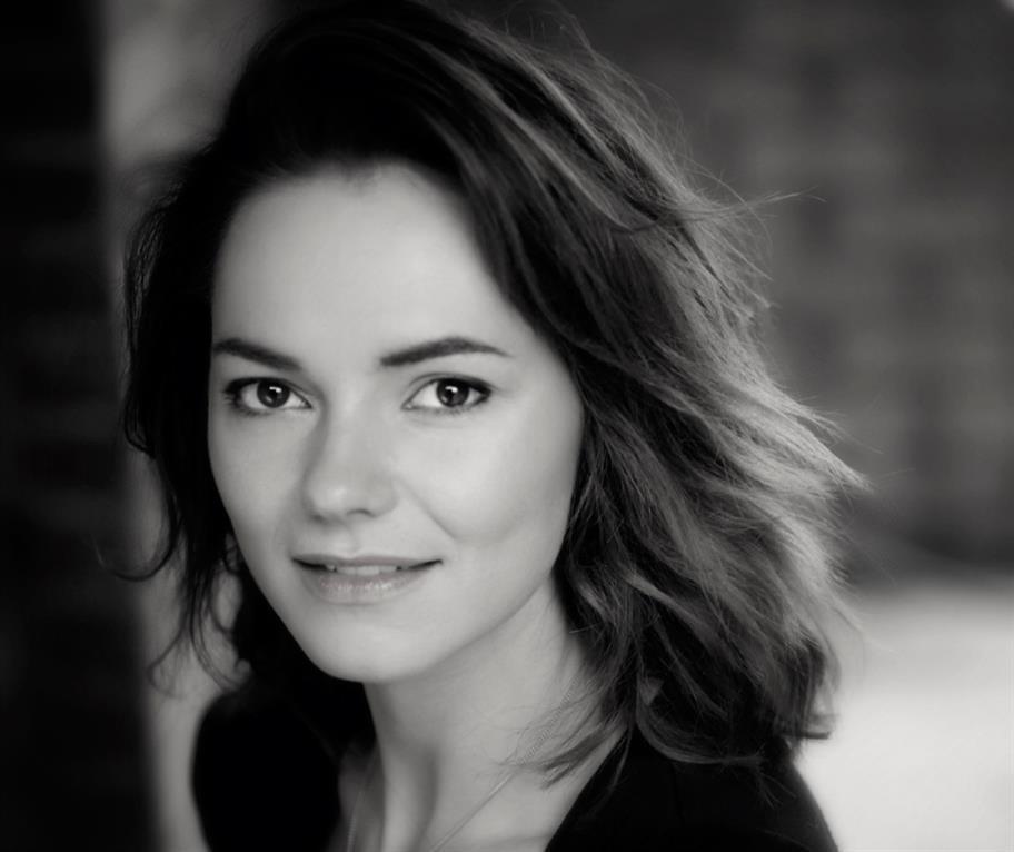 headshot of Kara Tointon