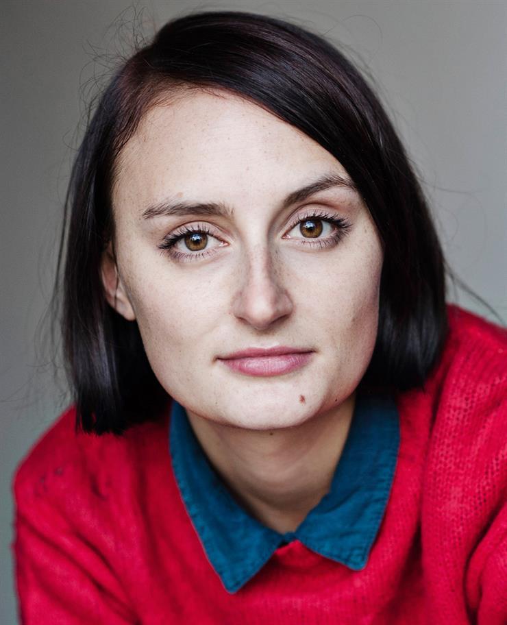 Headshot of Laura Elsworthy staring at camera