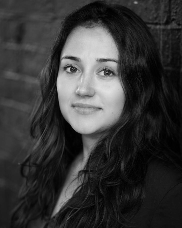 Black and white headshot of Laura Kirman