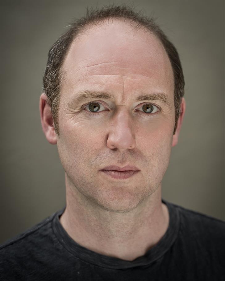 Headshot of Matthew Pigeon in black and white