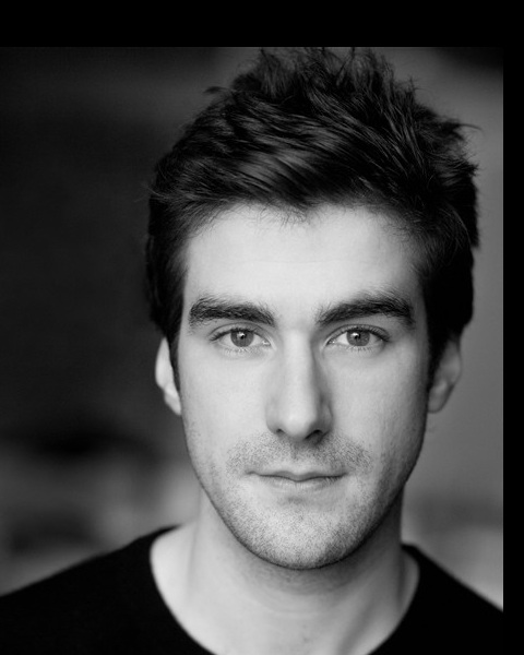 headshot of Nicholas Bishop