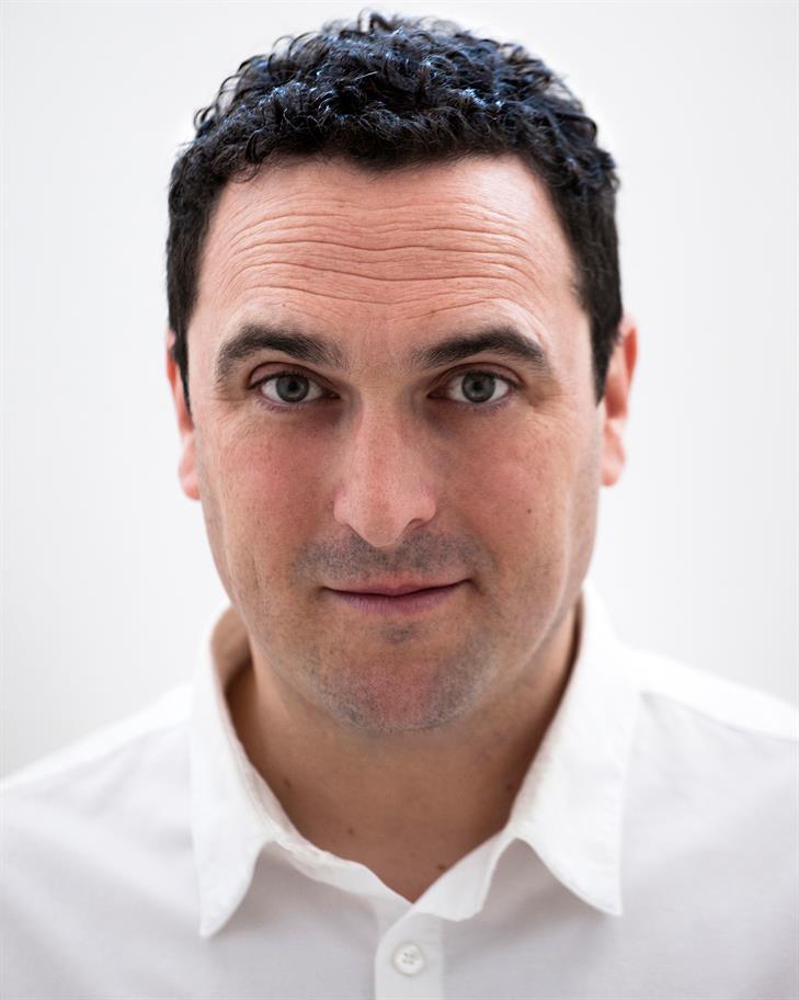 Ben Roddy headshot wearing a white shirt