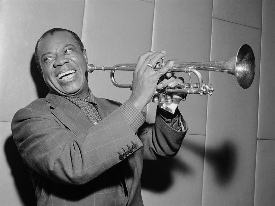 Louis Armstrong with his trumpet.