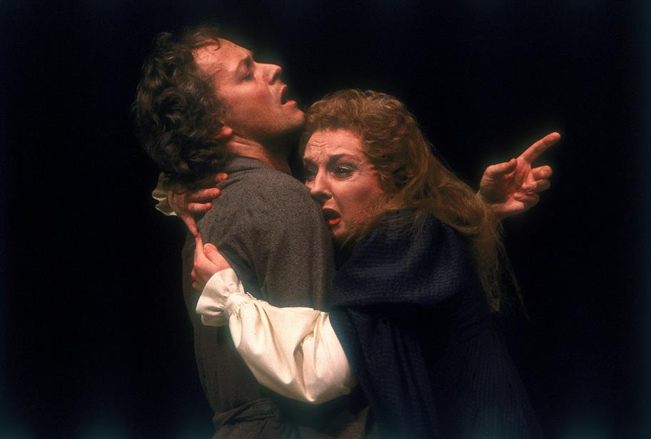Gertrude clutches Hamlet in despair while Hamlet looks pained