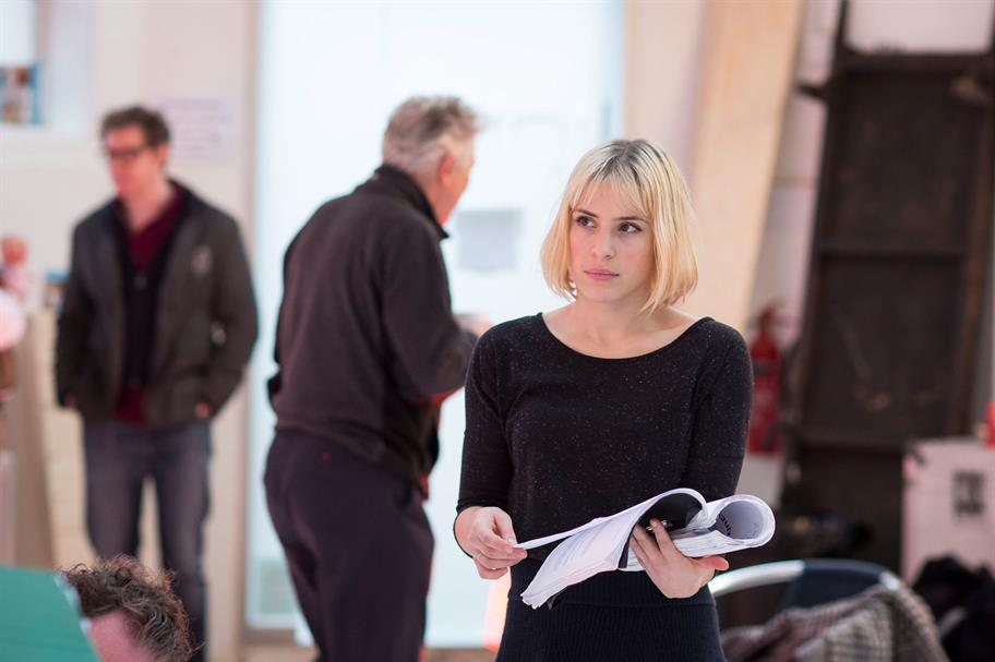 Eleanor Wyld holding a script in rehearsals.