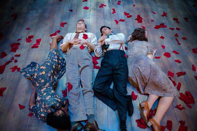 Four people lie on the floor