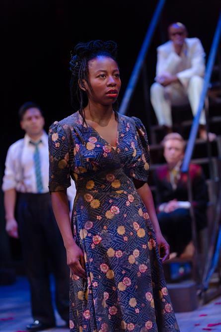 A woman in a floral dress looks troubled