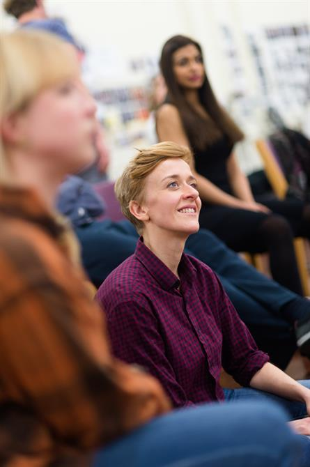Lucy Ellinson smiles at the camera in rehearsal
