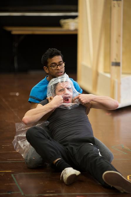 Hiran Abeysekera putting a plastic bag over Oliver Johnstone's head