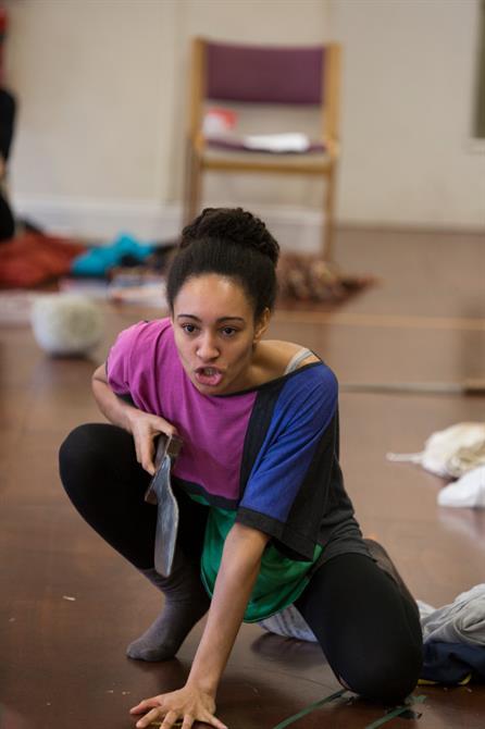 Natalie Simpson crouching on the floor