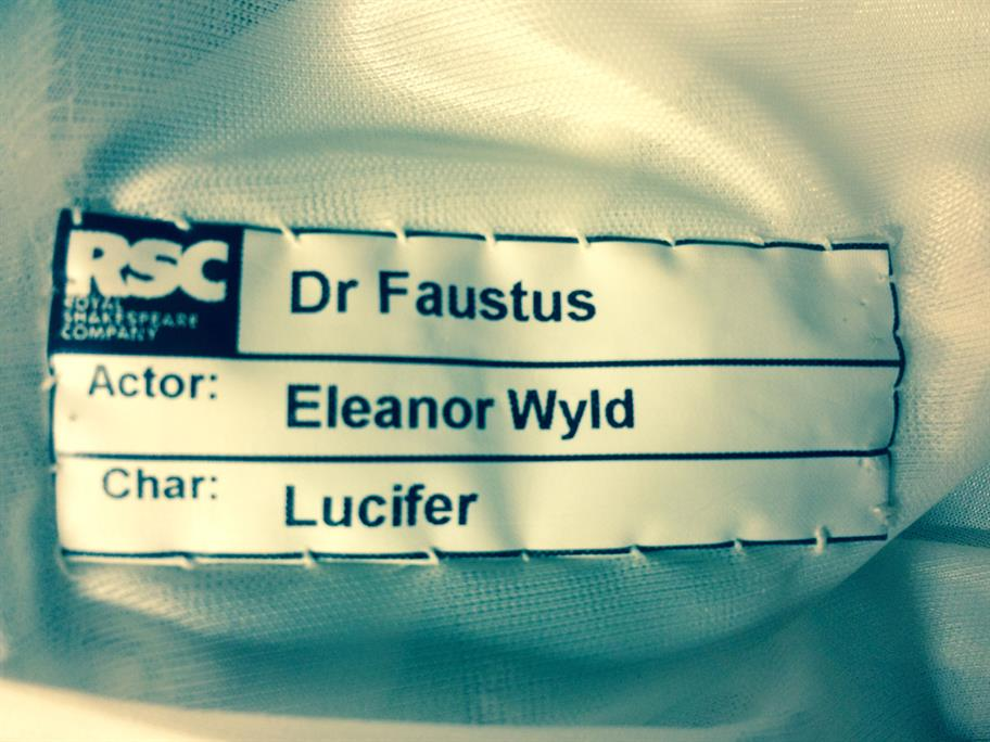 A costume label reading: Dr Faustus, Actor Eleanor Wyld, Char Lucifer