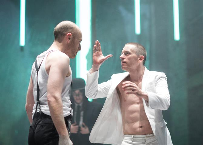 Sandy Grierson as Doctor Faustus and Oliver Ryan as Mephistophilis face off against each other