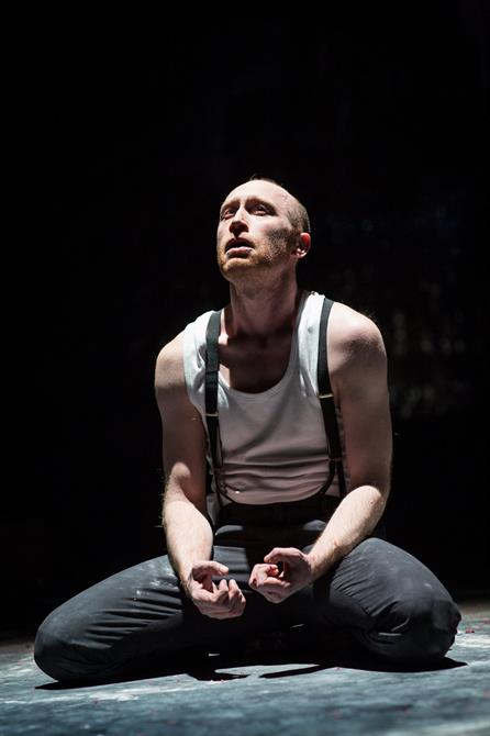 Sandy Grierson as Doctor Faustus, sat on the floor with his hands clenched