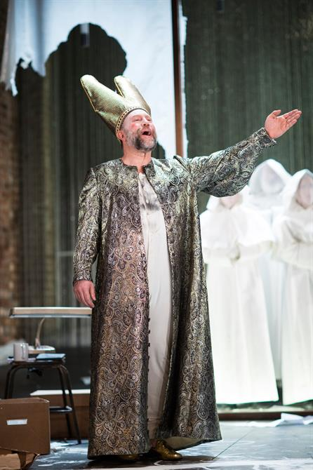 Timothy Speyer as Pope in Doctor Faustus, wearing a tall golden hat and long robe