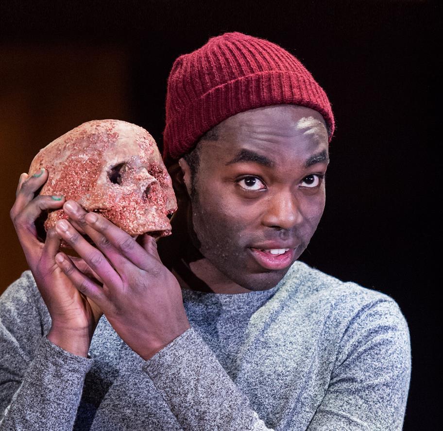 Paapa Essiedu as Hamlet, carrying a skull