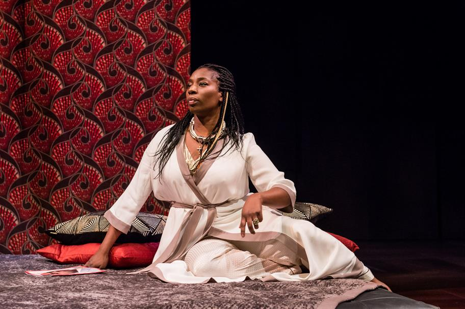 Tanya Moodie as Gertrude seated on the floor in a white robe