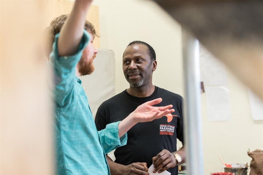 Director Simon Godwin talking to Cyril Nri in Hamlet rehearsals