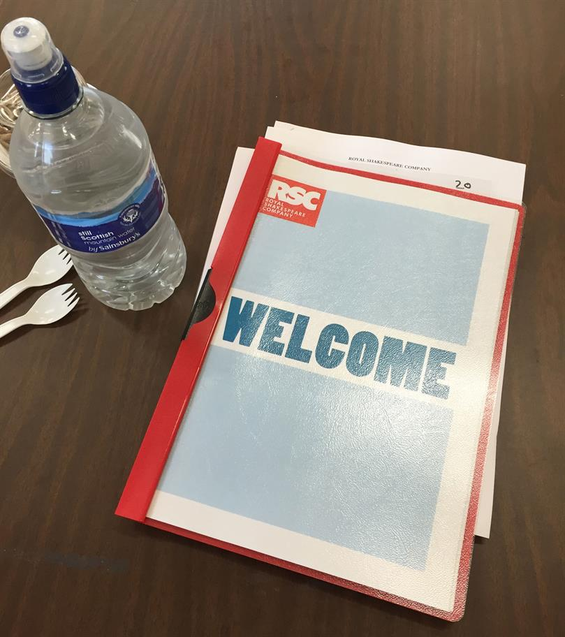 The Welcome pack for Hamlet with a bottle of water and two plastic forks