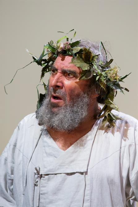 Antony Sher as King Lear - he wears a wreath on his head and is wearing his underclothes