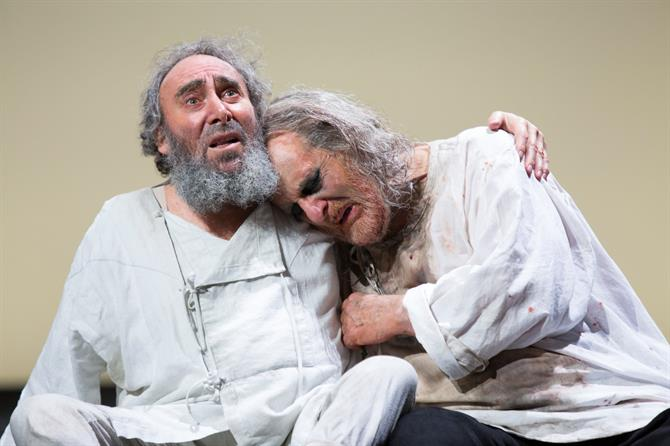 King Lear sits with his arm around Gloucester who looks upset