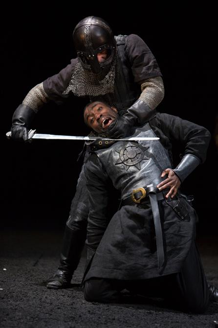 A masked knight holds a sword to Edmund's neck