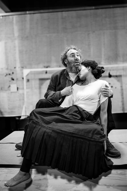 Natalie Simpson laying on Antony Sher in rehearsal for King Lear
