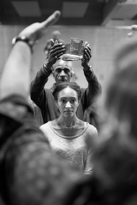 Ewart James Walters putting a crown on Natalie Simpson's head in rehearsal for King Lear