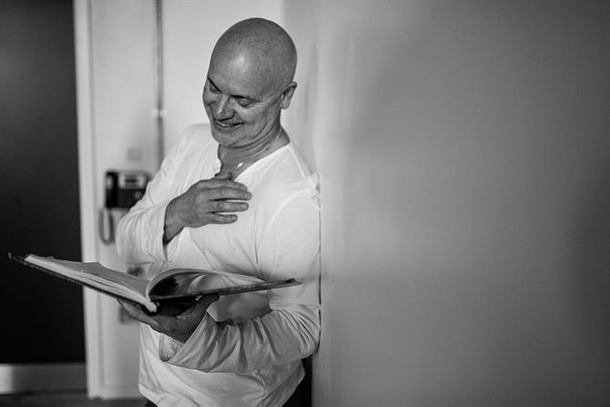 Graham Turner in rehearsal for King Lear reading a book