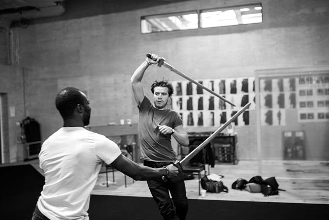 Paapa Essiedu and Oliver Johnstone sword fighting