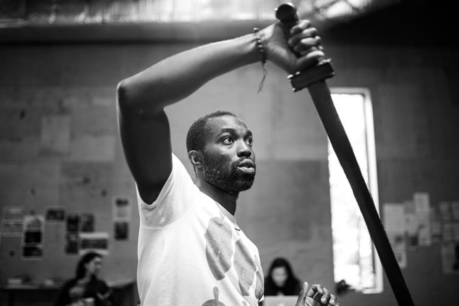 Paapa Essiedu in rehearsal for King Lear sword fighting
