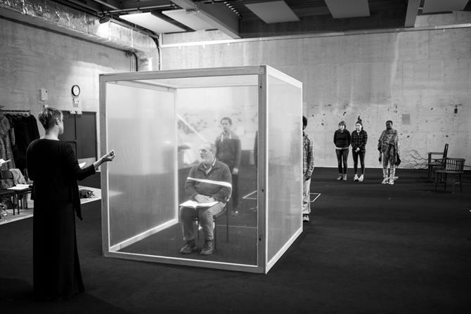 The Company in rehearsal for King Lear. The set contains a large clear box