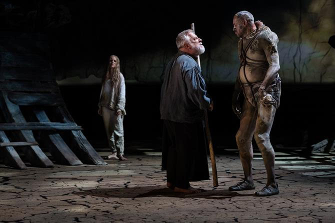 Miranda looking at Prospero and Caliban having a conversation