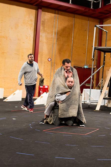 Tony Jayawardena watches  Joe Dixon and Simon Trinder who are covered by a blanket