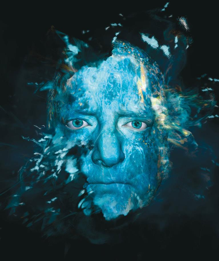 Simon Russel Beale as Prospero, the image of his face covered in blue and gold and seems to be dissolving