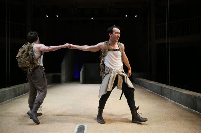 James Corrigan as Palamon and Jamie Wilkes as Arctie shaking hands as they walk away from eachother