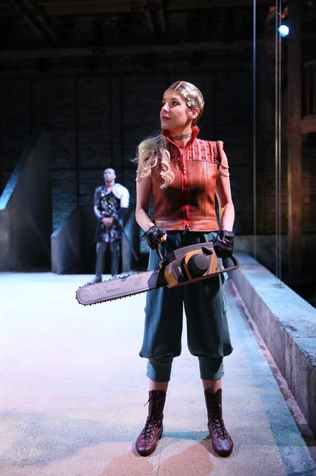 Allison McKenzie as Hippolyta with a chainsaw looking to her right