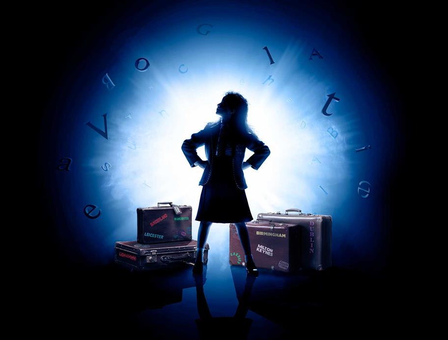 school girl in spotlight surrounded by suitcases