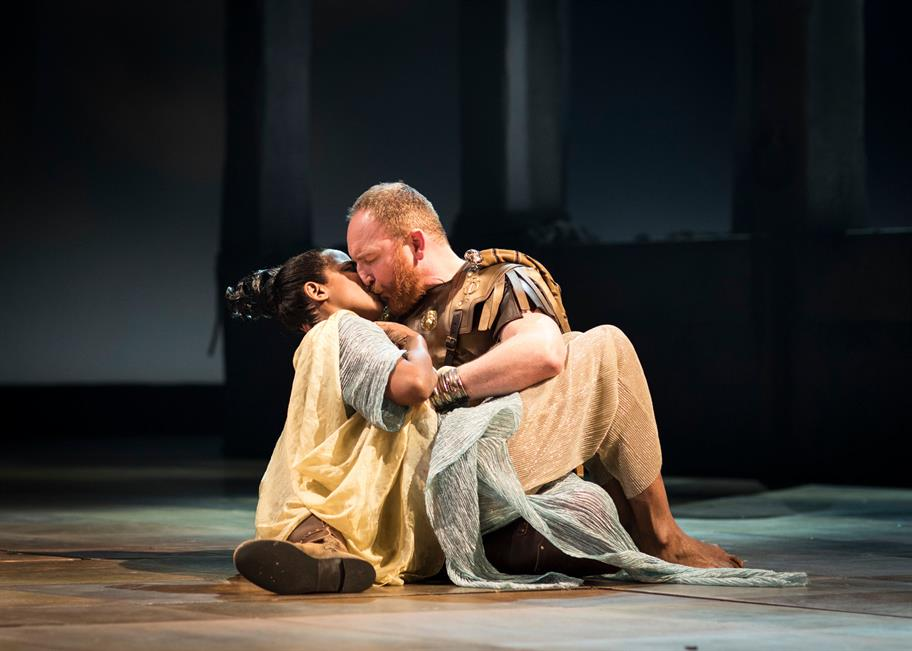 Cleopatra and Mark Antony kissing on the floor