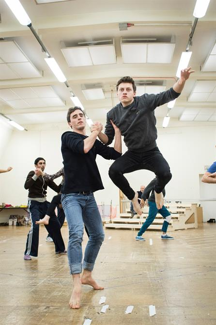 Jon Tarcy holding Luke MacGregor while he jumps in the air