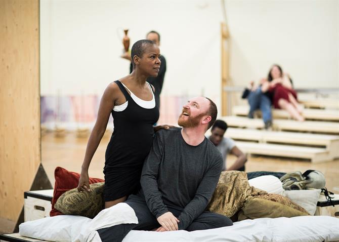 Josette Simon kneeling over Antony Byrne