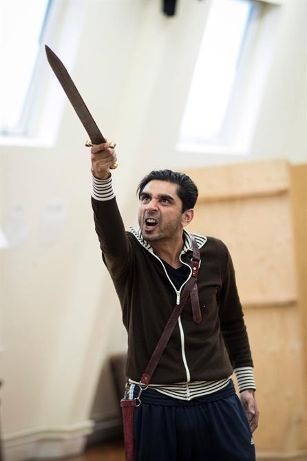 Dharmesh Patel holding a sword