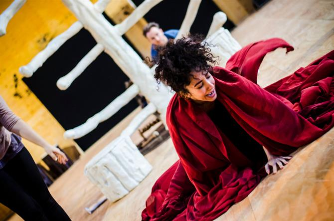 Sarah Kameela Impey in rehearsal for First Encounters: The Tempest crying and wearing a red robe.