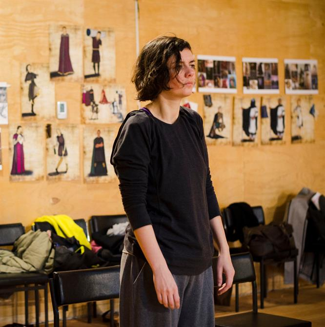 Laura Cairns in rehearsal for First Encounters: The Tempest standing with her hands by her side