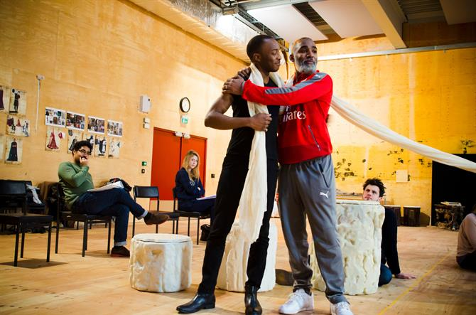 Caleb Frederick and Darren Raymond in rehearsal for First Encounters: The Tempest, standing and hugging each other