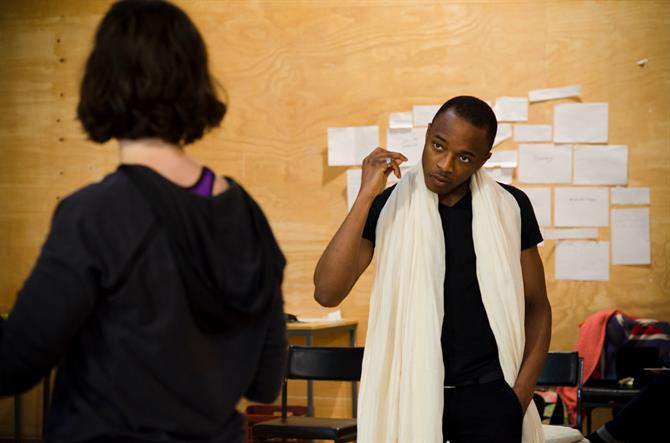 Caleb Frederick in rehearsal for First Encounters: The Tempest,  with a white cloth around his neck