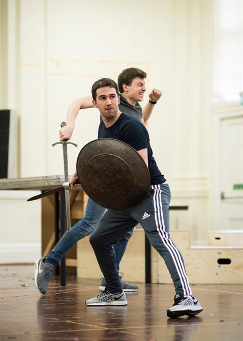 two men with swords and sheilds rehearsing a fight