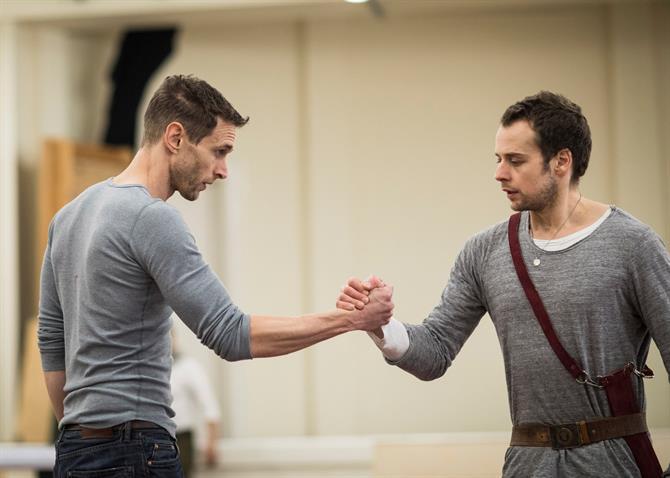 Martin Hutson and Alex Waldmann hand shaking handing